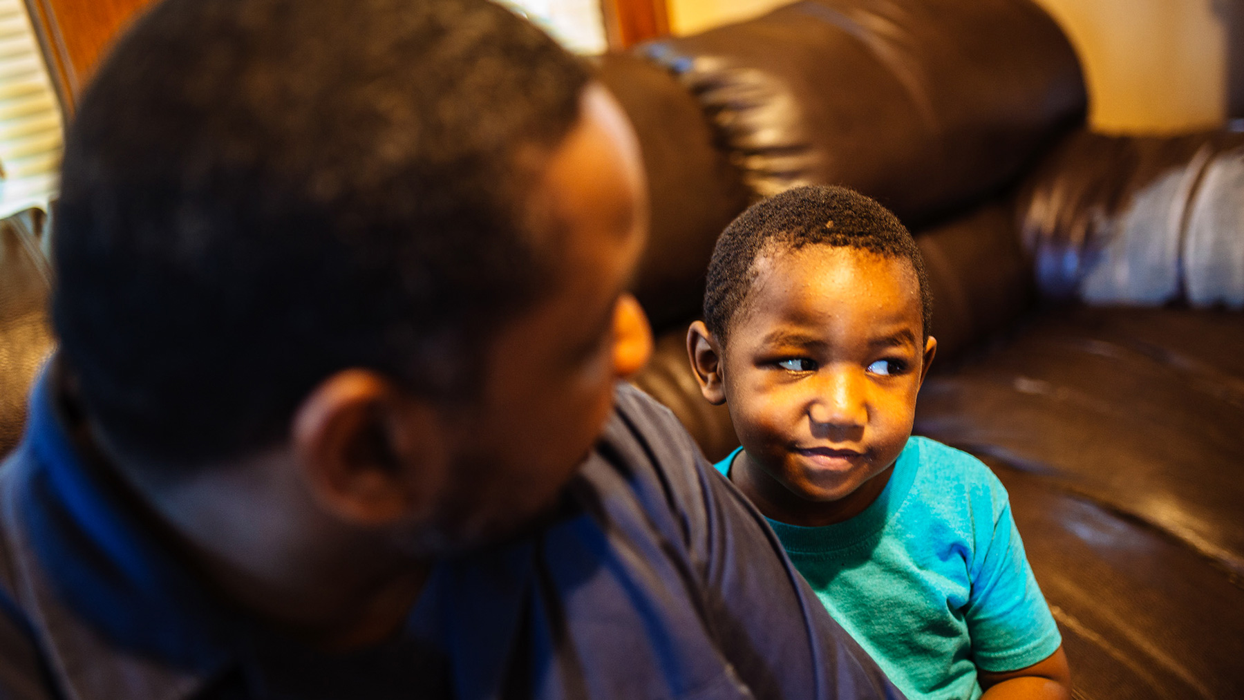 Tory Lowe and his 4-year-old son, Troy, sit in their Milwaukee home. In December, Tory learned that his son had lead poisoning. (Michael M. Santiago/News21)