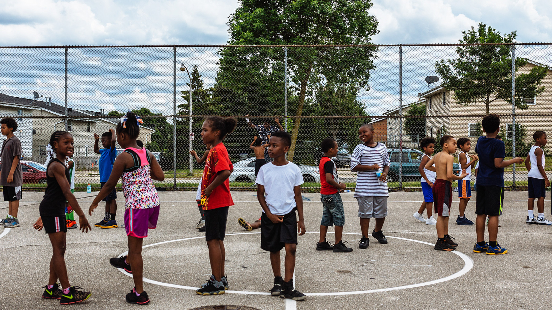 Children from the north side of Milwaukee line up for basketball practice in the first junior basketball league day of the summer. (Michael M. Santiago/News21)
