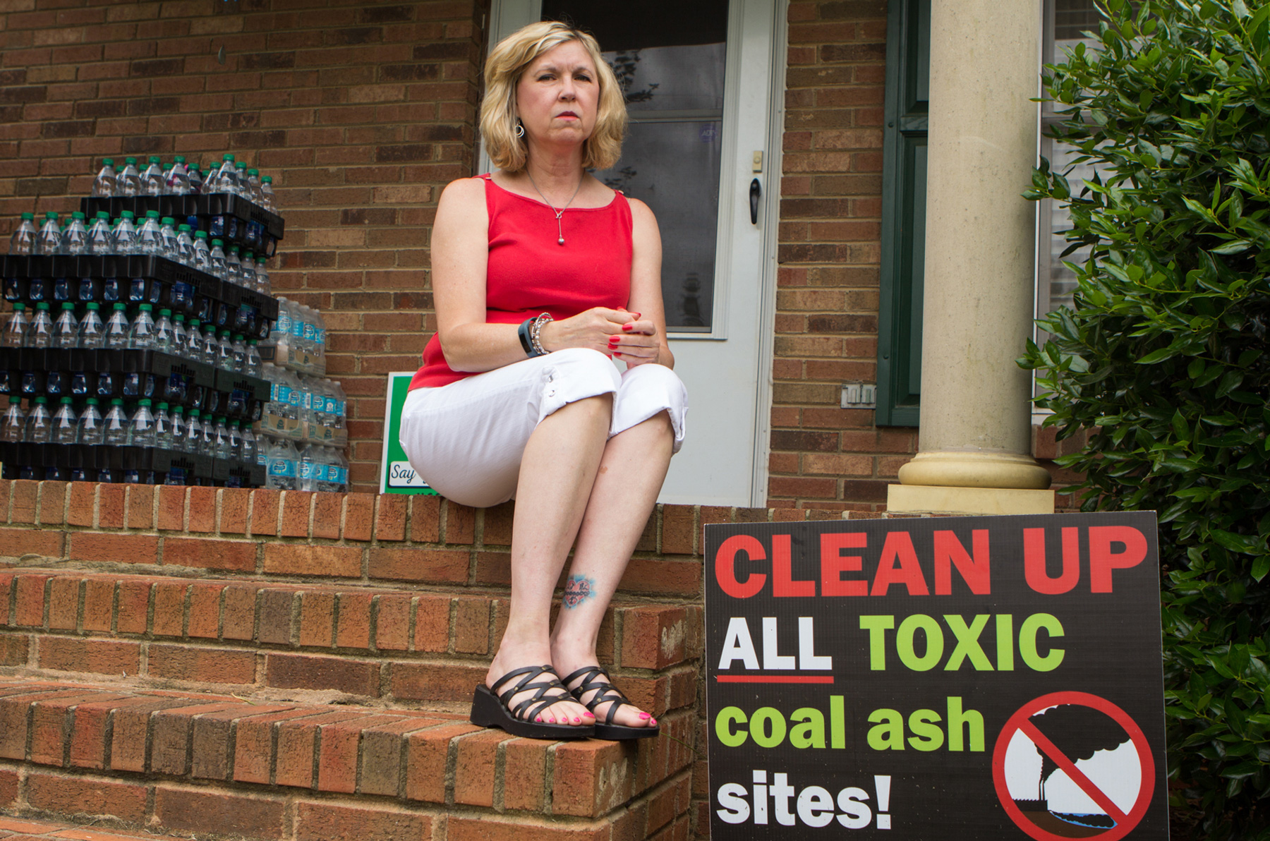 Debbie Baker sits in front of her Belmont, N.C., home. She has been an outspoken advocate against coal ash since contaminants were found in her water since 2015. (Jasmine Spearing-Bowen/News21)