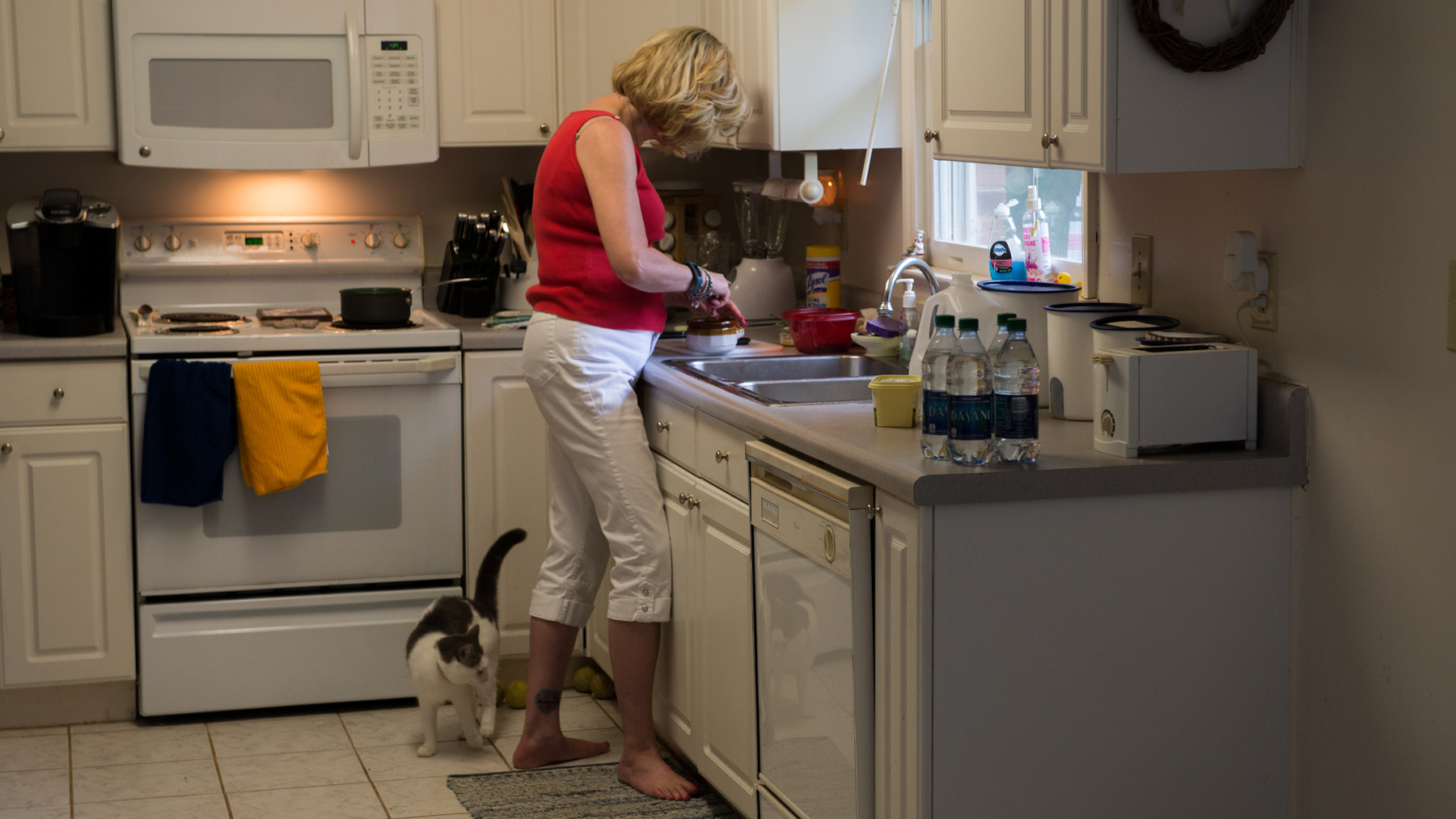 Debbie Baker prepares food in the kitchen of her Belmont, N.C., home. She uses bottled water to drink and cook with. (Chelsea Rae Ybanez/News21)