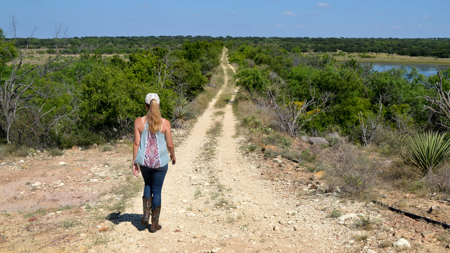 Beef farmer Amy Greer walks along the property line of her ranch in Brady, Texas. Her family is working with city officials to prepare easements for a new water system. (Elizabeth Sims/News21)